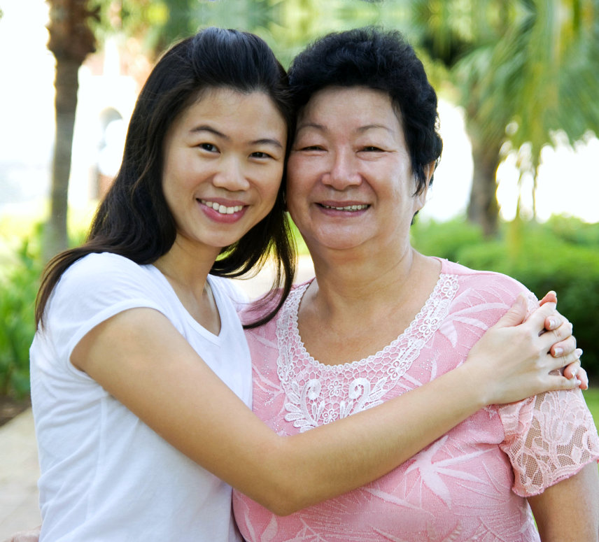 young caregiver and senior woman are smiling