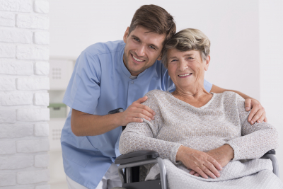 nurse hugging senior woman