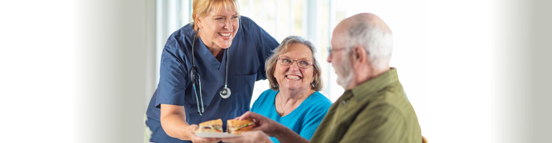 nurse serving senior couple